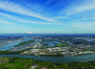 Aerial image of the confluence of the Columbia and Willamette Rivers and the Port's Rivergate Industrial Park